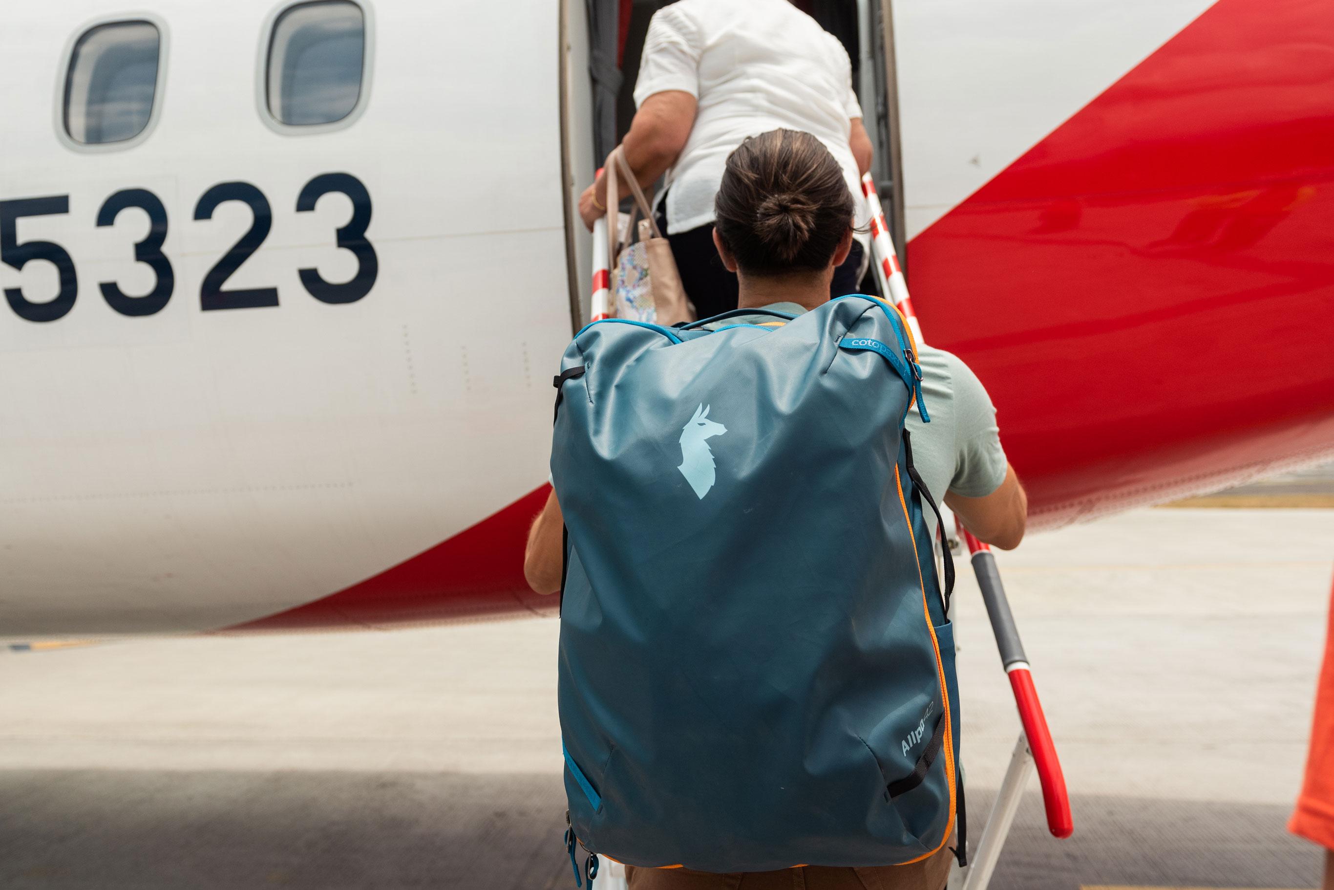 Cotopaxi Allpa 42 boarding plane travel luggage