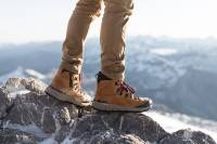model standing on rock wearing canvas pants and Danner Arctic 600 Best Boots