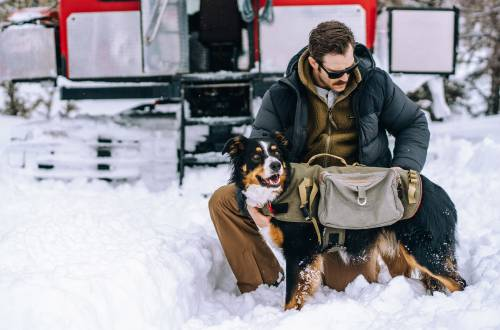 Man with his dog wearing a Filson Featherweight Down Jacket