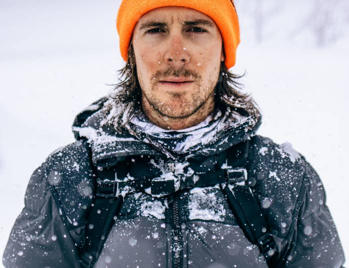 Man in Snow Wearing Filson Featherweight Down Jacket