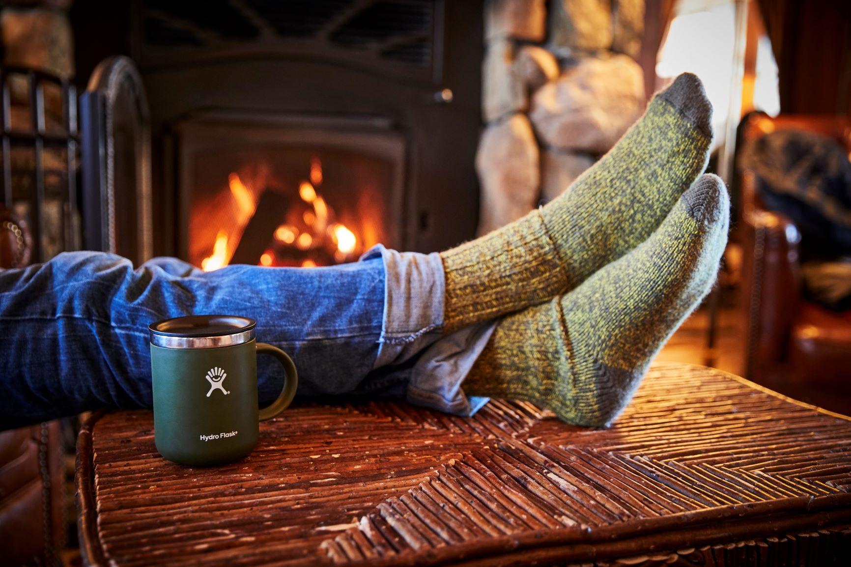 Hydro Flask Coffee Mug near fireplace