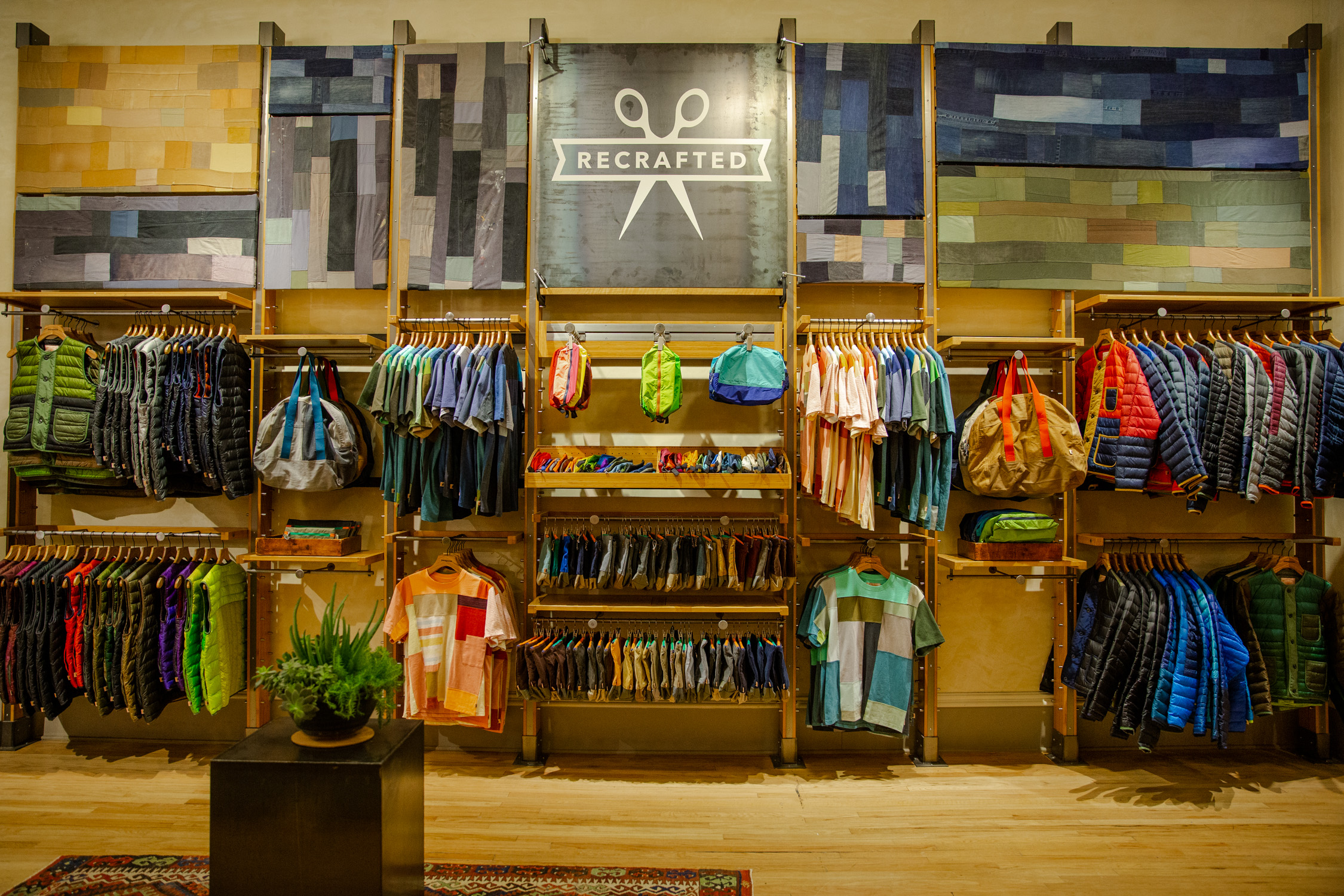 A wall with different Worn Wear items on hangers in Patagonia store