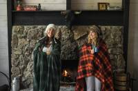 Ladies in Wrapped in Blankets By Fireplace REI