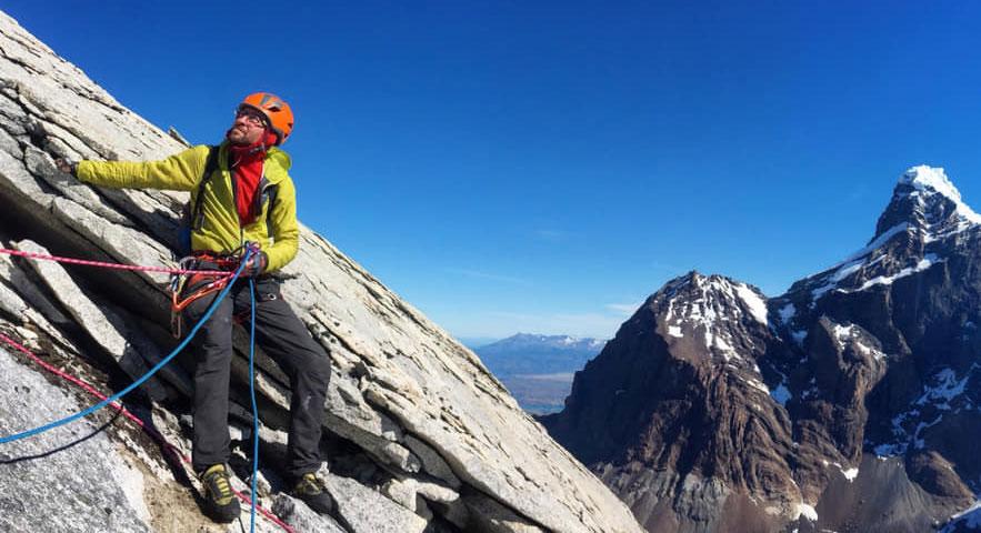 Climber sitting on crag