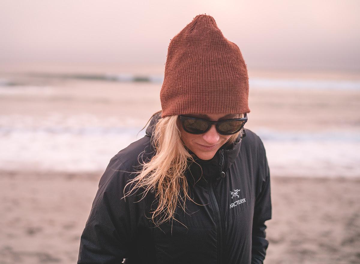 Woman in an Arc'teryx Jacket on a Beach.