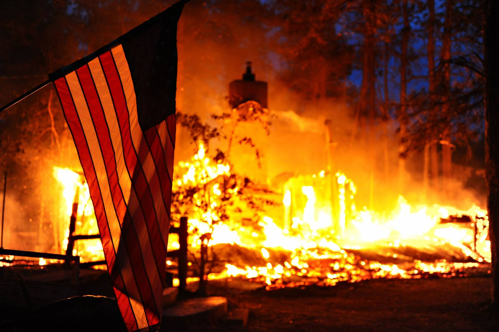 American flag in forest fire