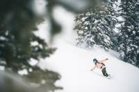 backcountry cyber sale woman snowboarding mountains