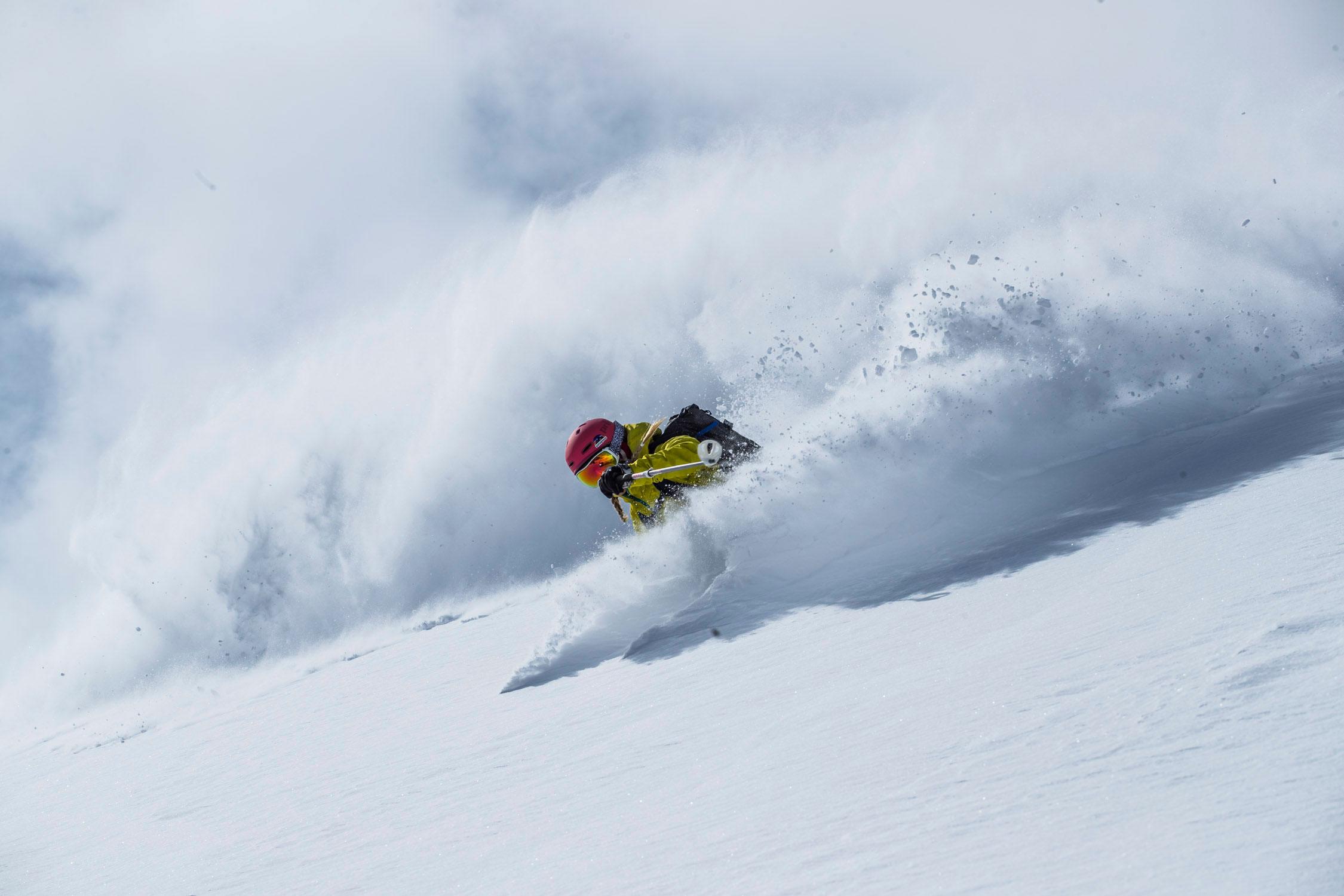 Skier turning pow in Patagonia gear
