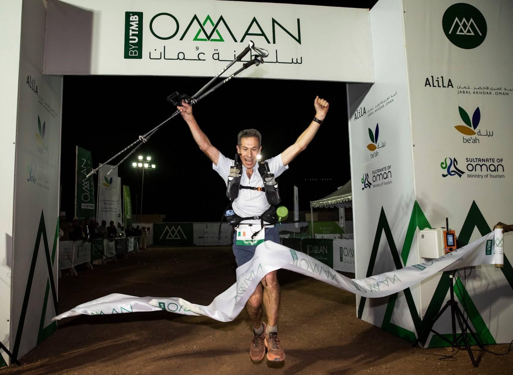 Men's winner of the 170 km race crosses finish line in Oman