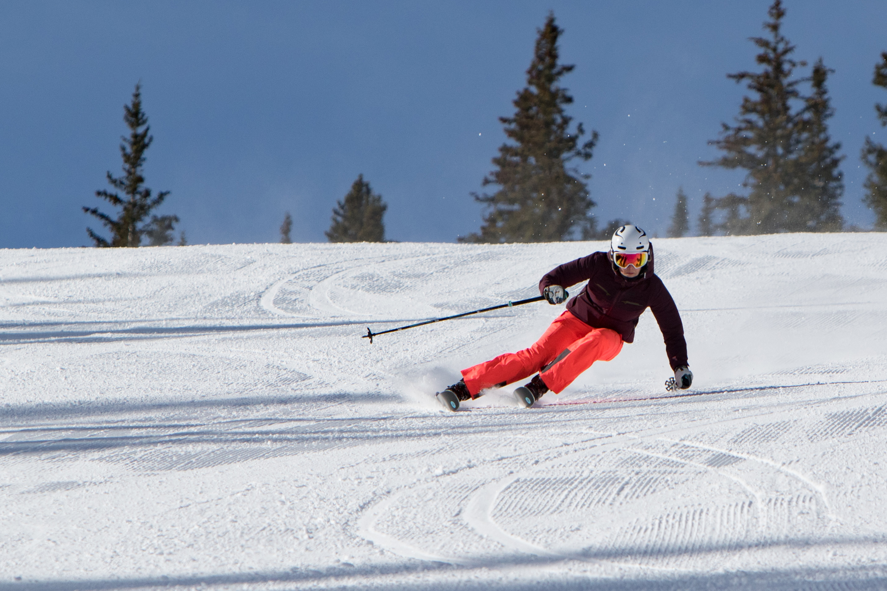 Skier carving turns