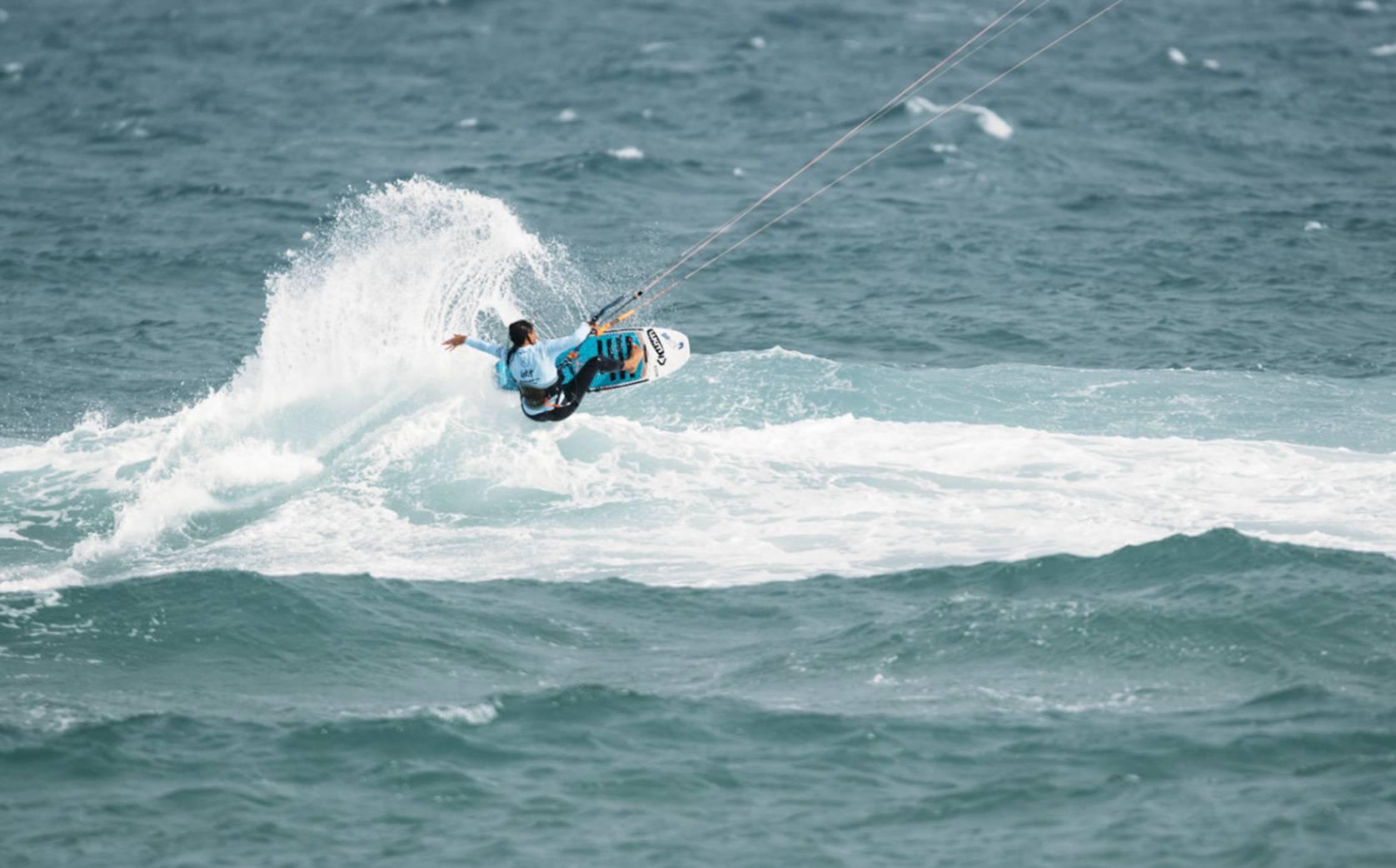 kite surfer hitting crest of wave