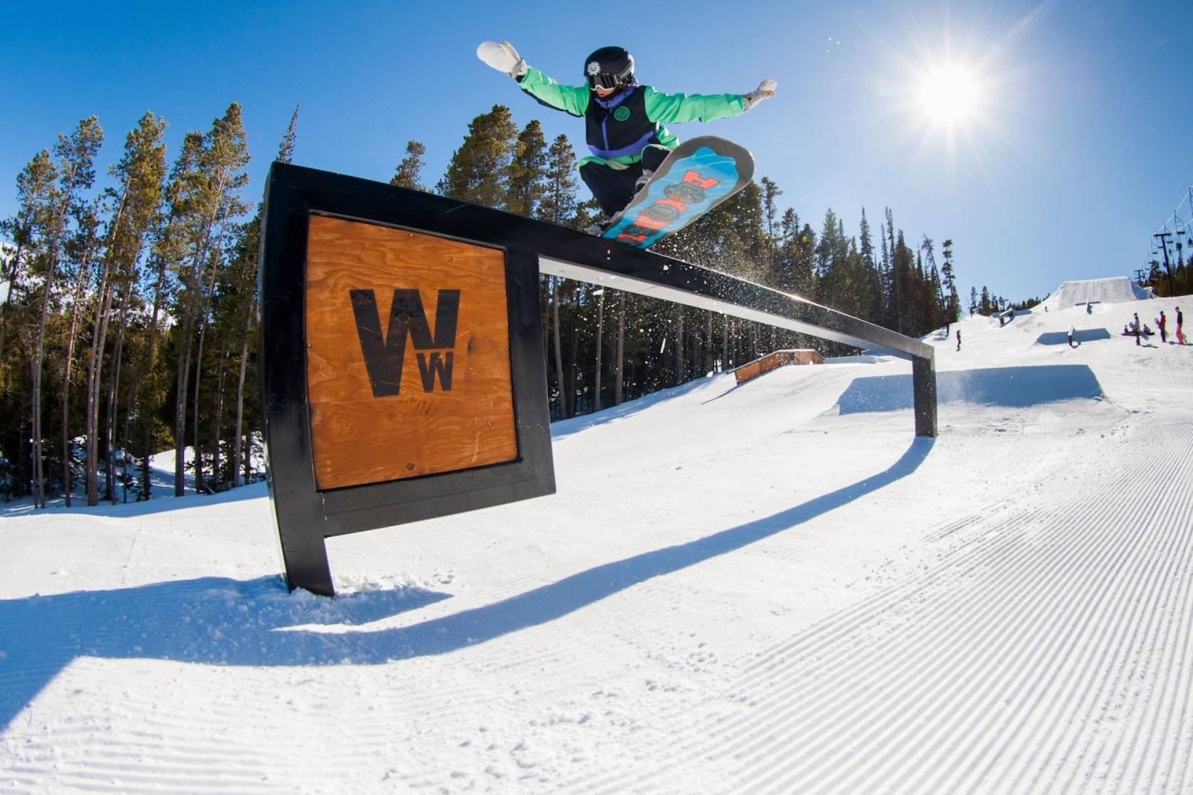 snowboarder riding rail at Eldora Mountain park in Ms. Superpark comp