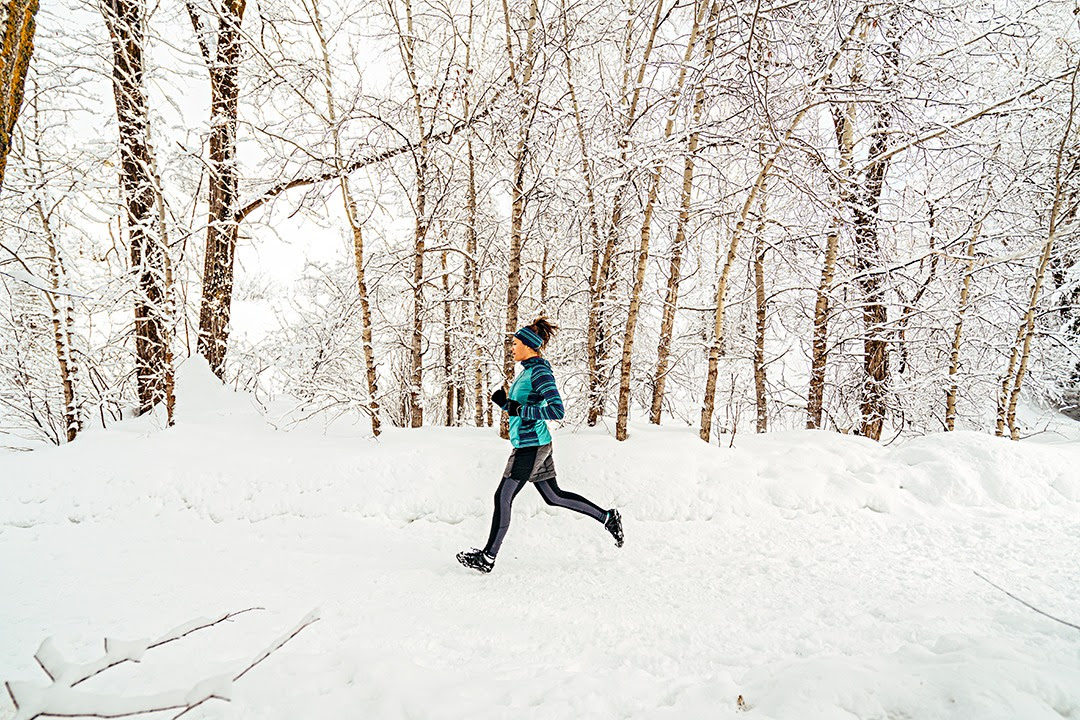 Person Winter Trail Running in the Snow