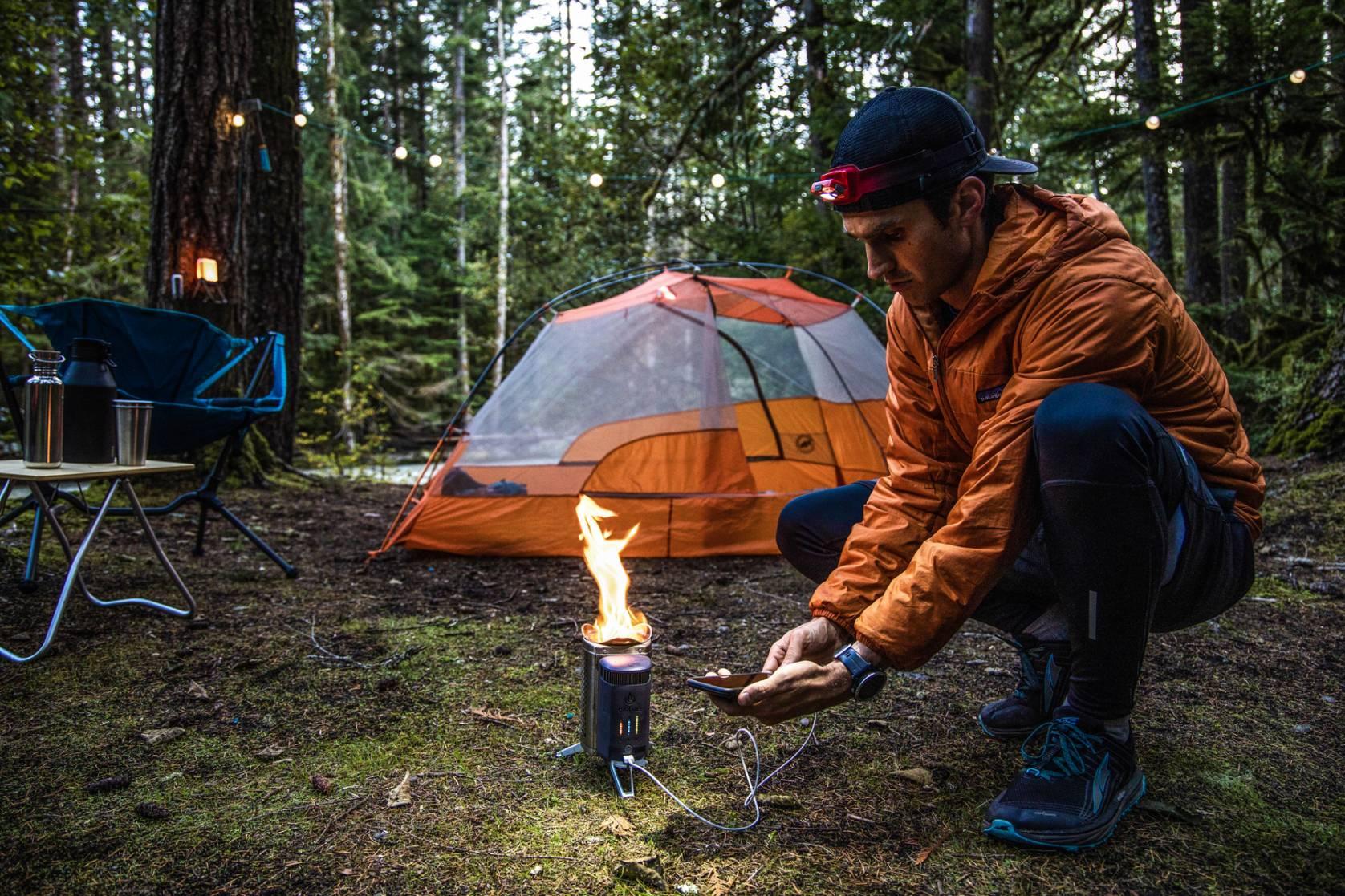 camper using a Climate Neutral BioLite CampStove 2 tentside