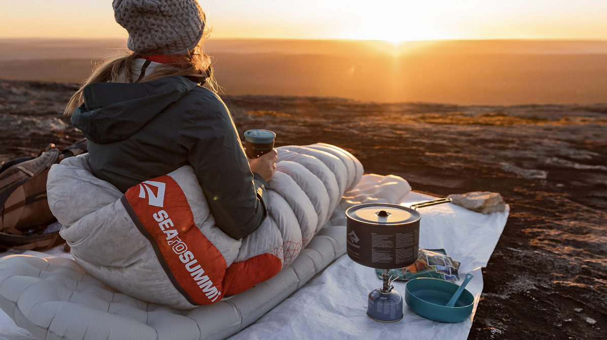 Woman Camping Using Sea to Summit Sleeping Bag Sleeping Pad Camp Stove