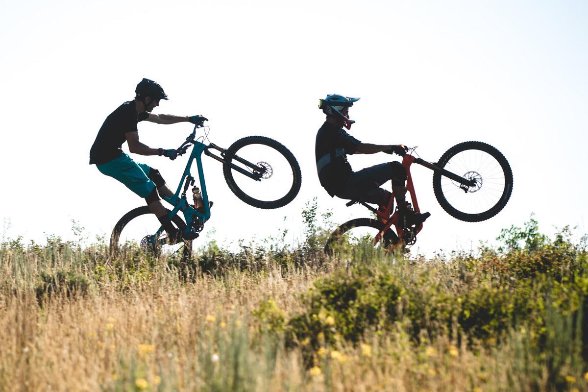 Mountain Bikers Doing Wheelies