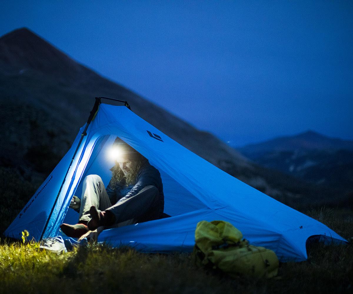Man Camping in Black Diamond Tent using Black Diamond Headlamp