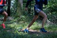 People Trail Running in Salomon Shoes