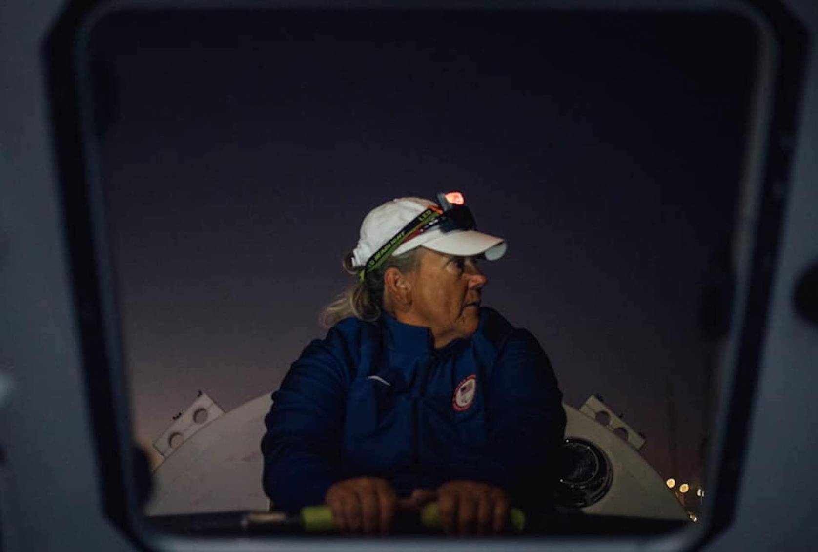 angela madsen rowing in hat and headlamp