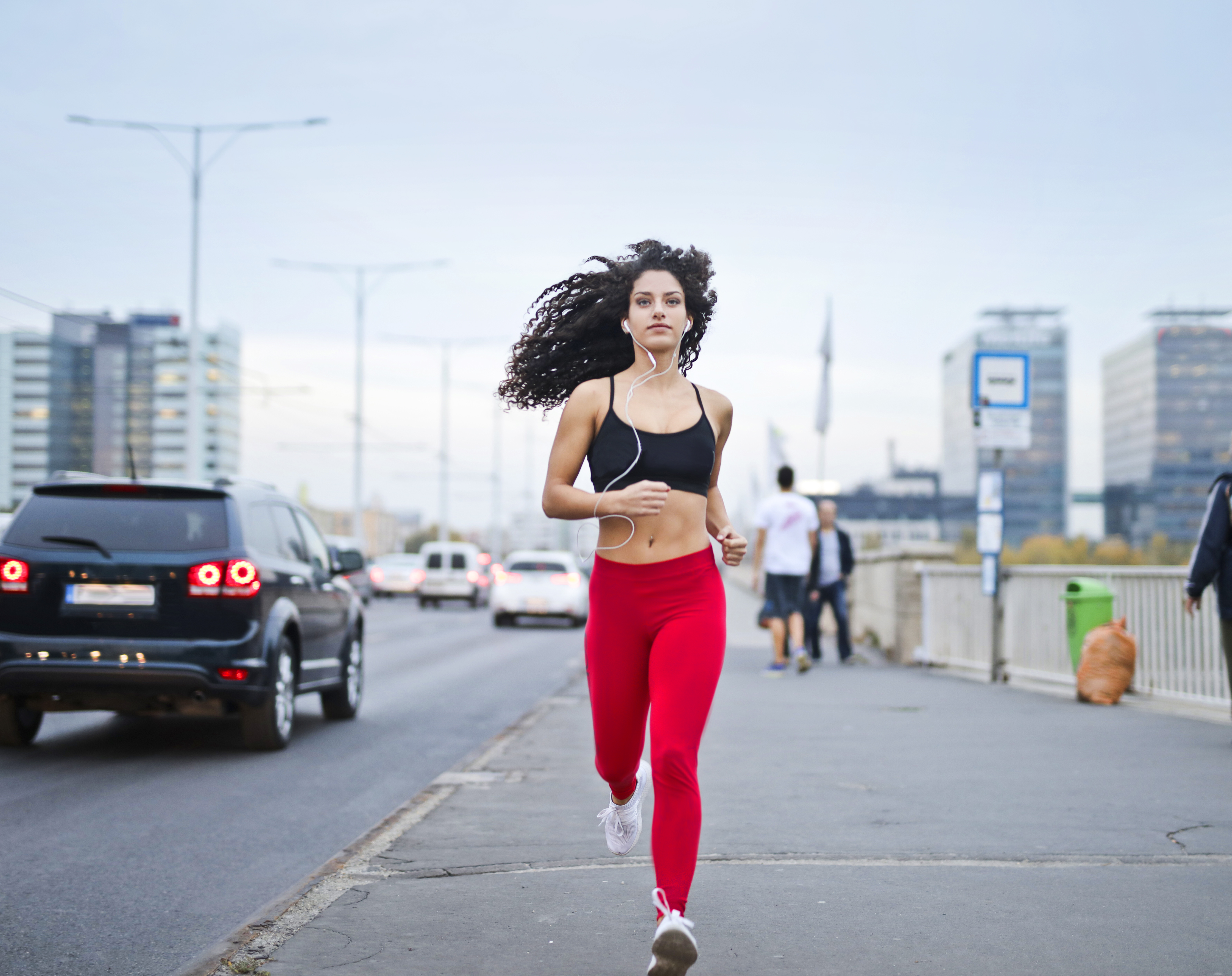 photo-of-woman-listening-to-music-on-earphones-running-down-3764537