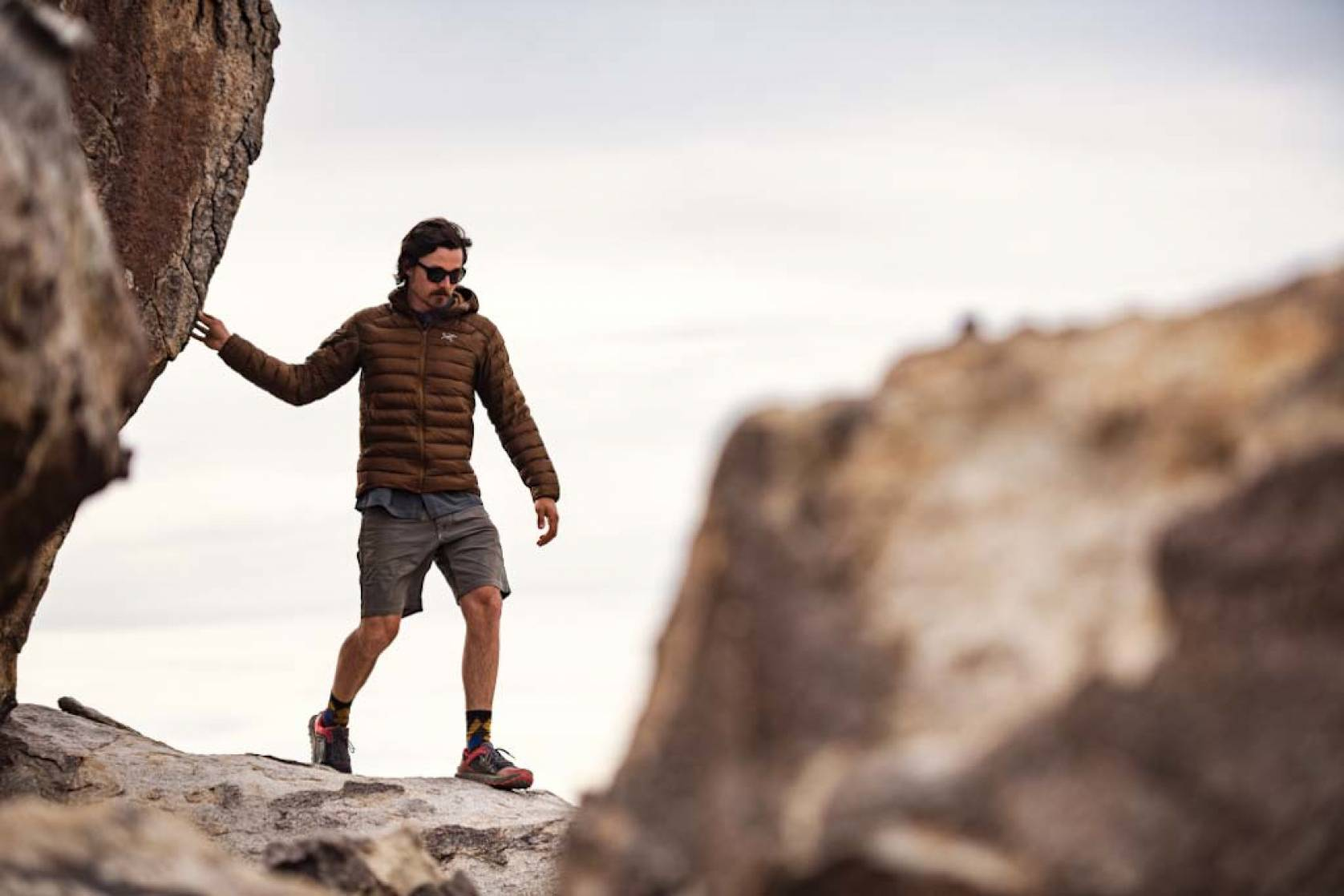 Man hiking along cliff