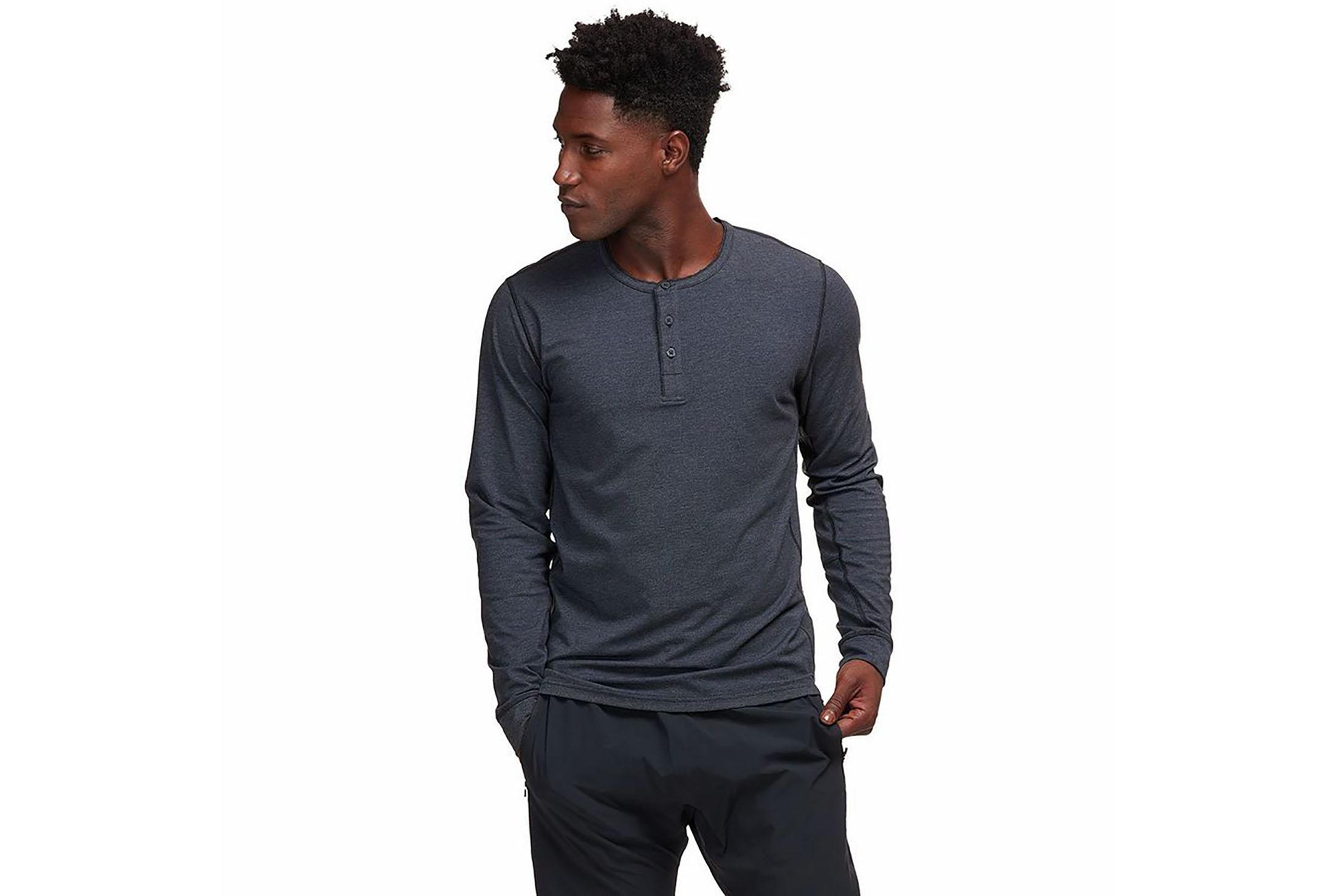 man wearing black henley shirt