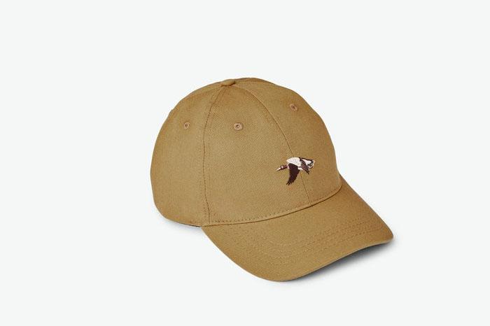 Tan baseball cap on white background