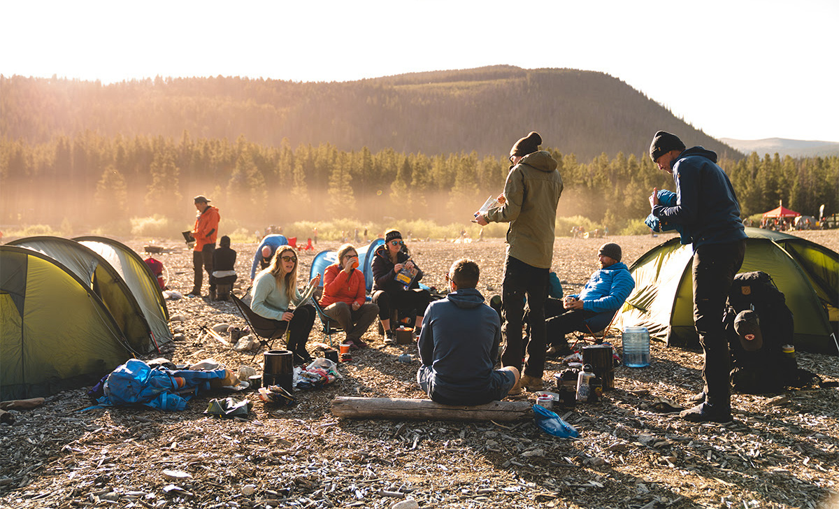 Group of People Camping and Eating
