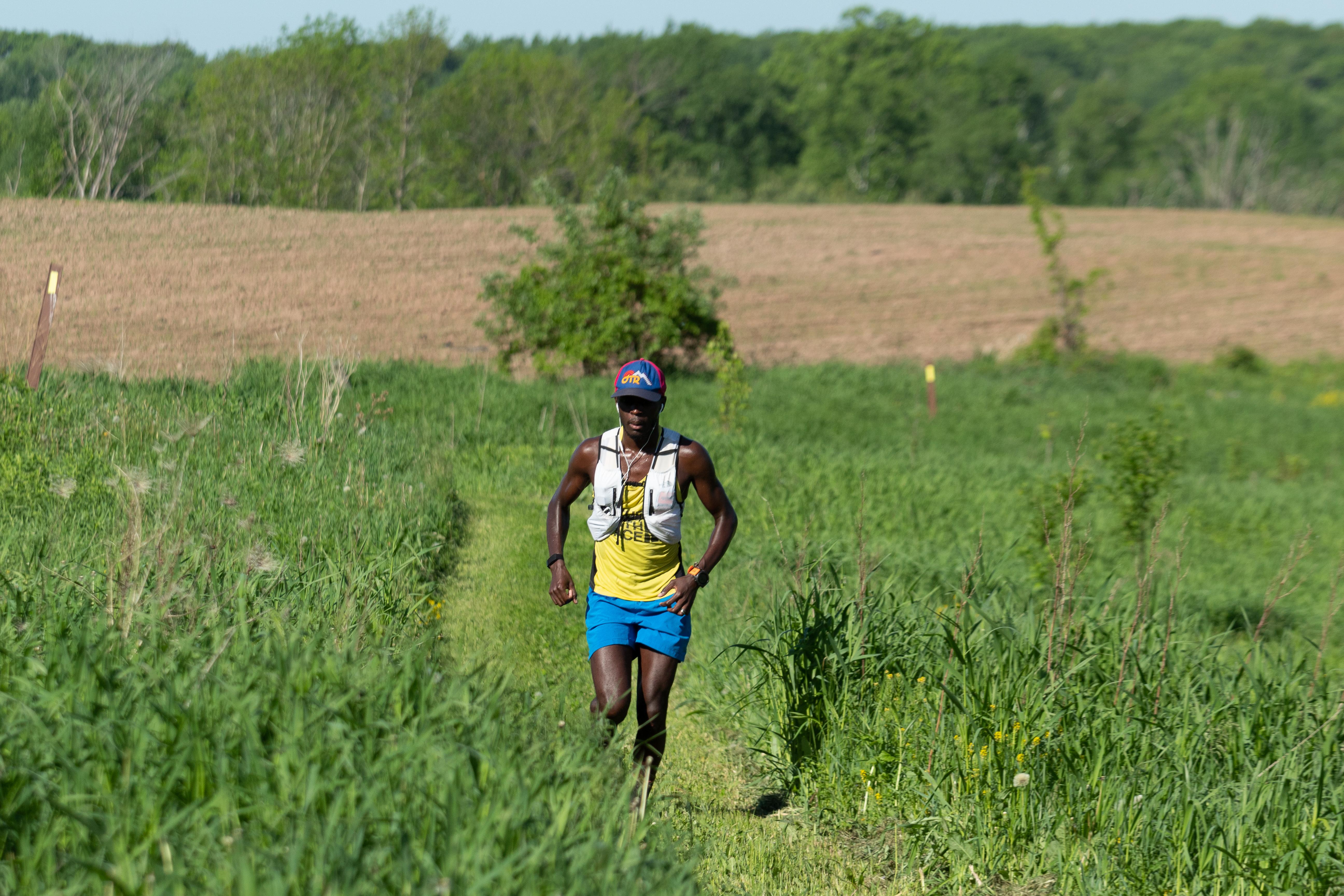 Coree Woltering running an ultra through a field