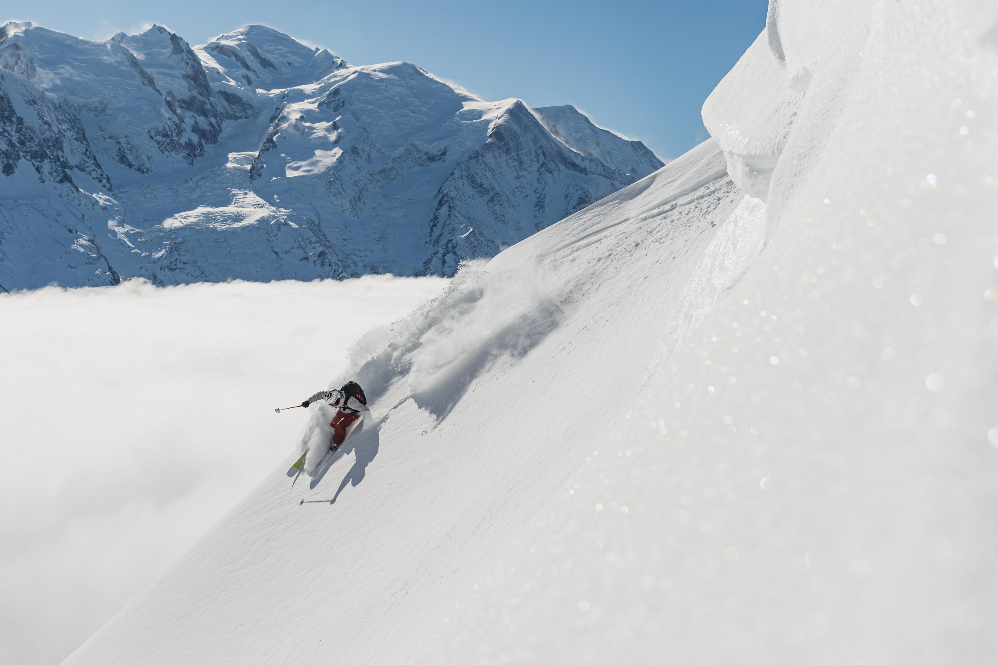 Skier making turn while wearing Helly Hansen Infinity Ski Jacket