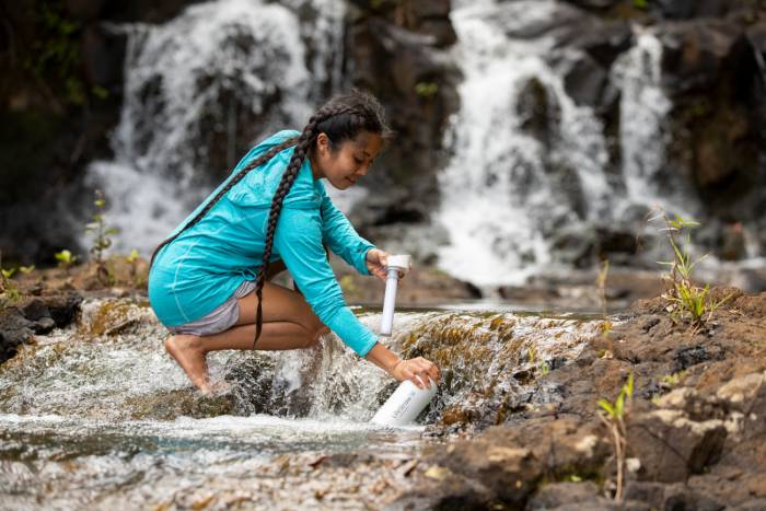 LifeStraw Go- stainless- steel - white - filling waterfall - kauai - adam barker - 2025