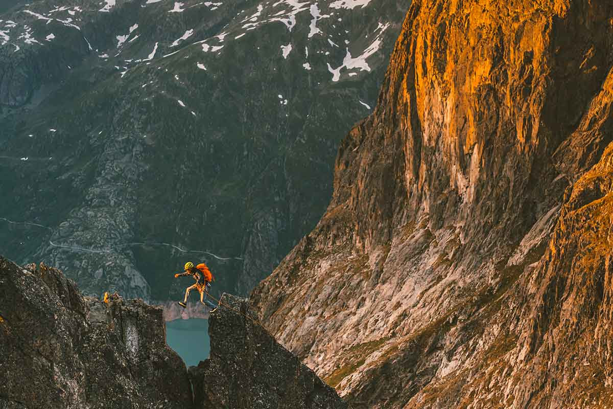 Rock Climber Jumping Across Cliffs in Arc'teryx Gear