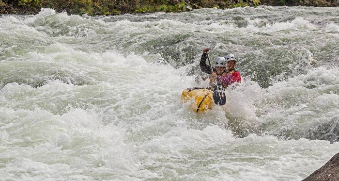 Jason and Chelsey Magness tackling whitewater in a double packraft.