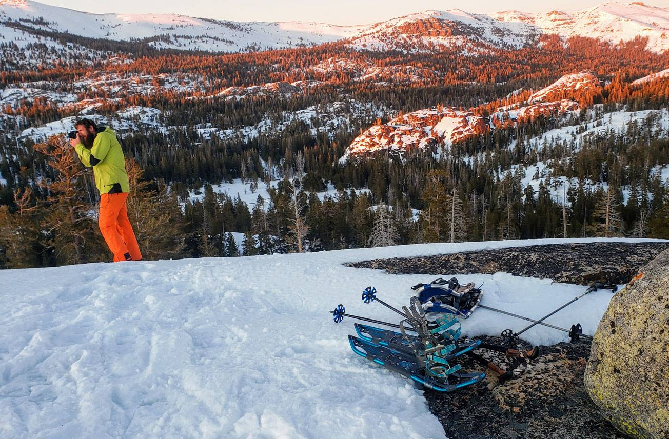 how to choose snowshoes. picture: snowshoes in light snow on the top of a mountain