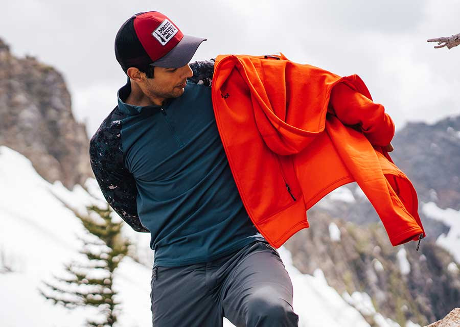 Person Putting on Marmot Layer