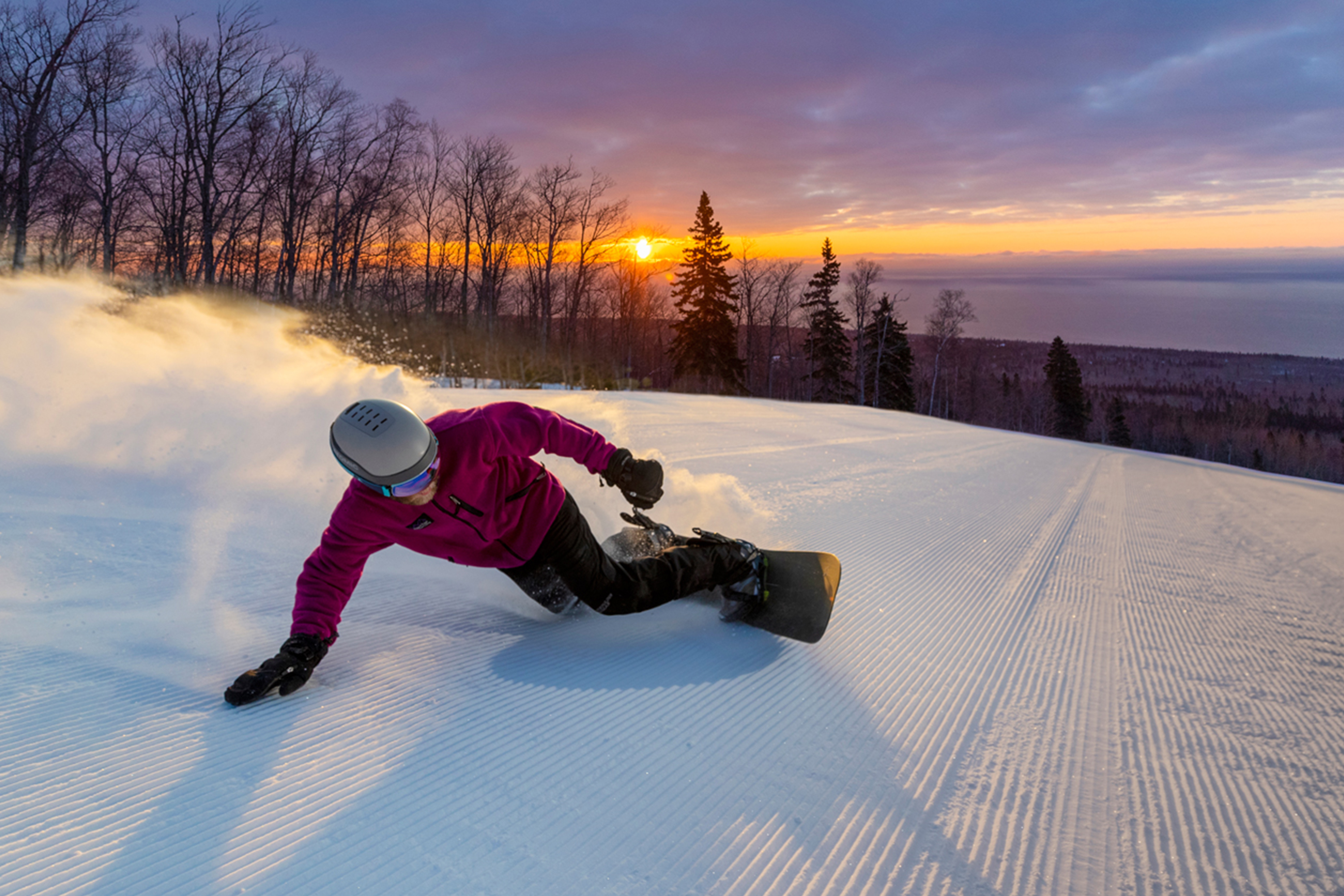 Person Snowboarding at Sunset
