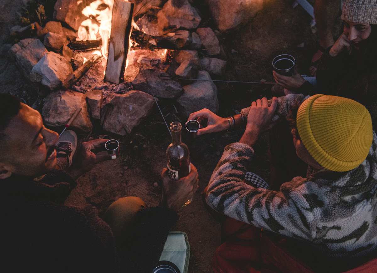 People Sitting Around Campfire Wearing Stoic Apparel