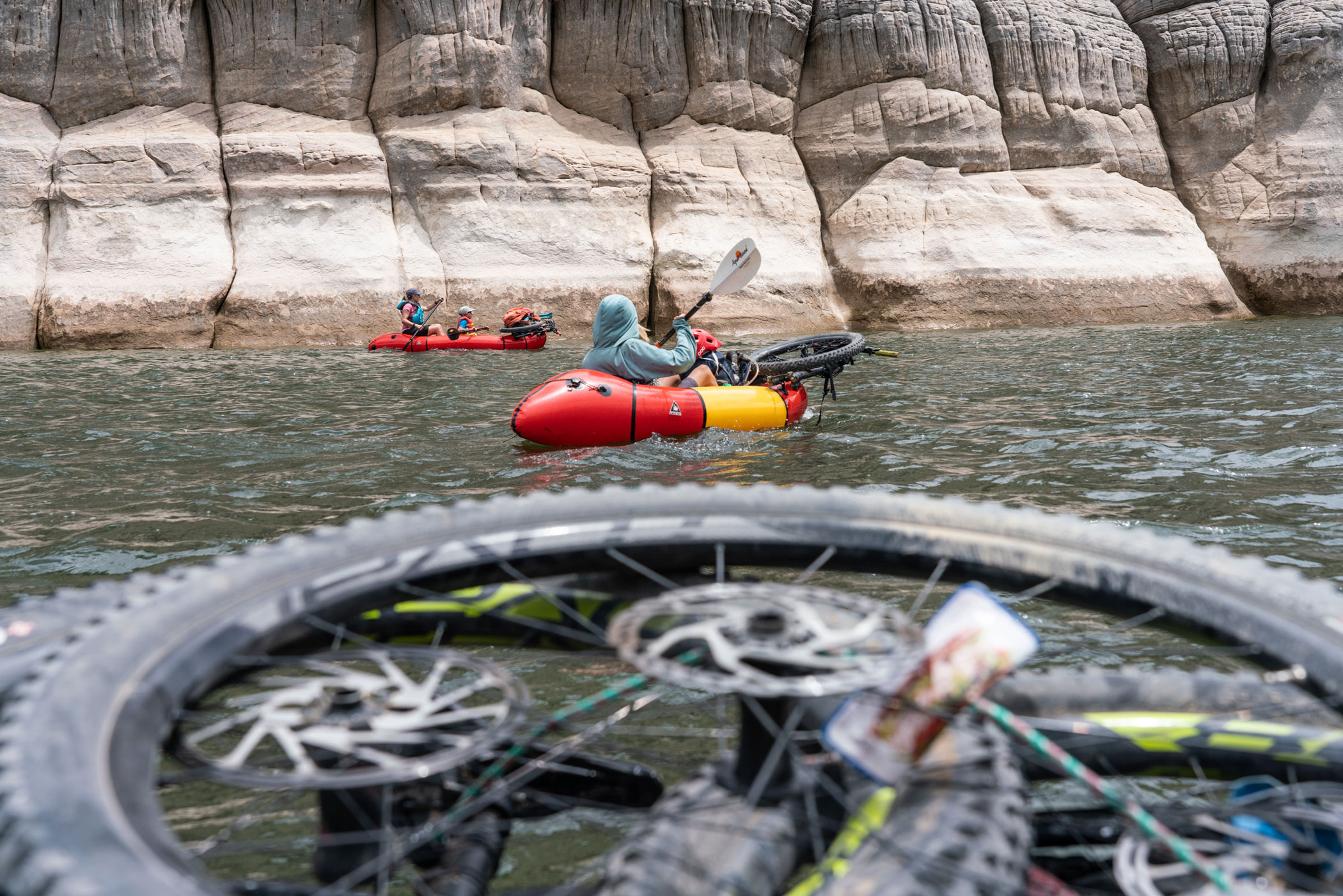 Wally Ferrell, 14, paddles solo on McPhee Reservoir, while Kari Bonardchuk and her son, Sam, 9, paddle a two-person packraft.