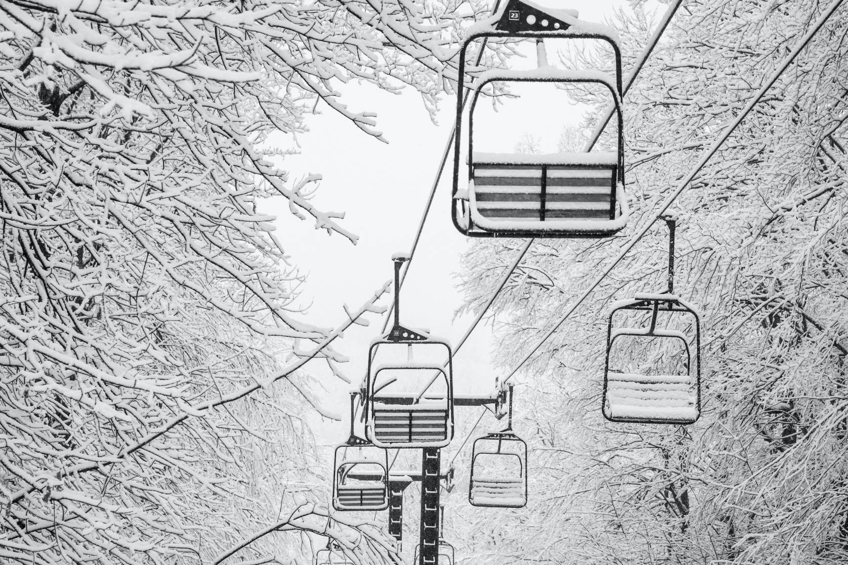 double chairlift covered in snow