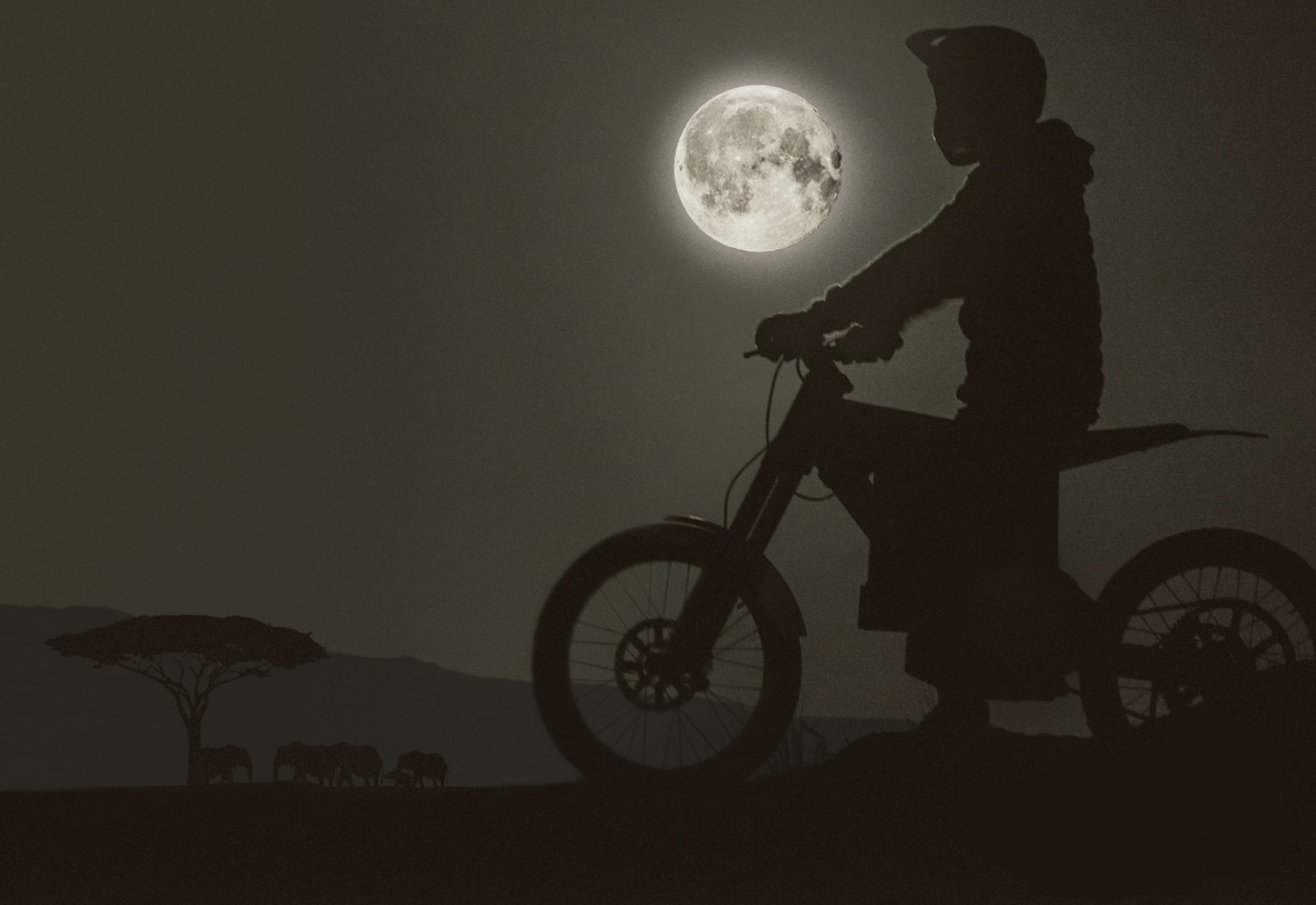 silhouette of rider in moto-helmet on a CAKE electric bush bike