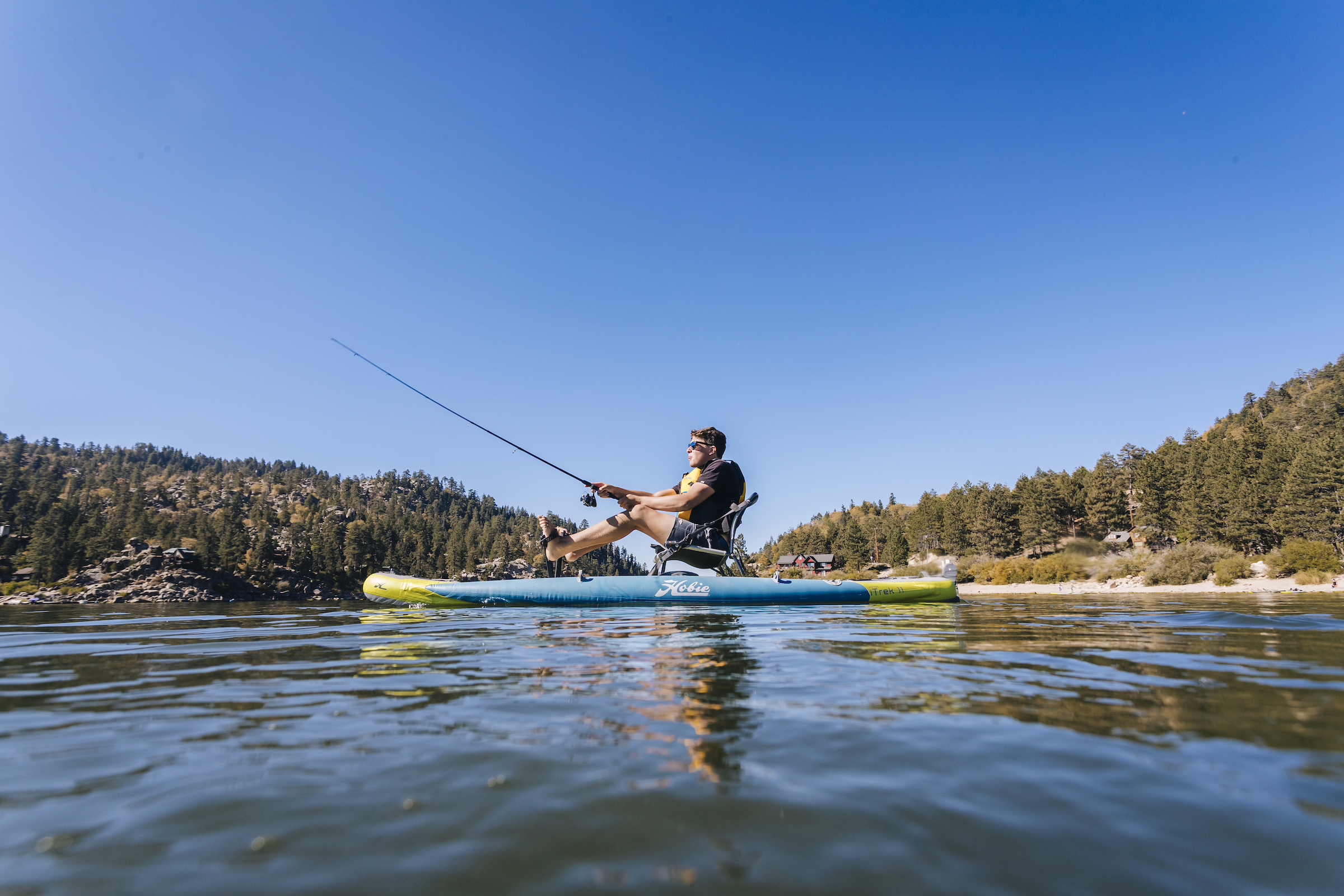 man seated and fishing from the hobie mirage kayak