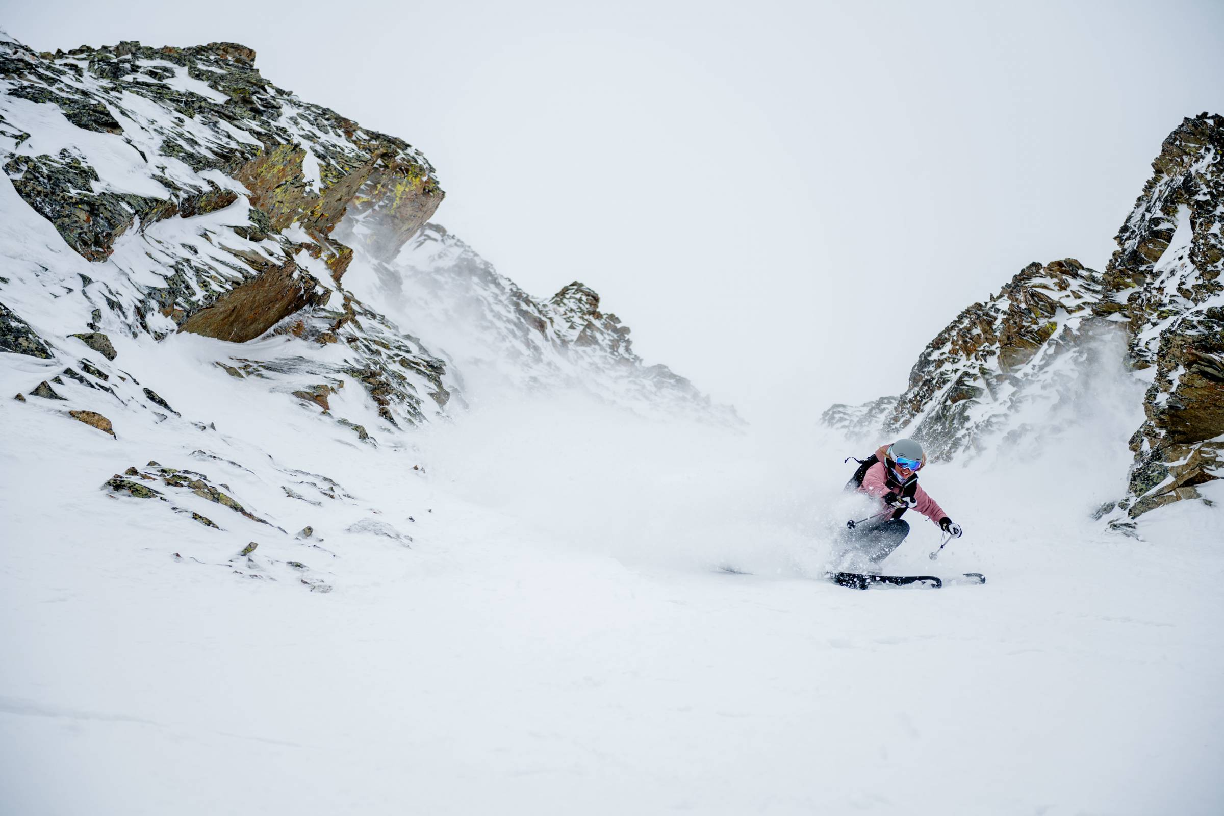 Backcountry Skier Skiing Couloir