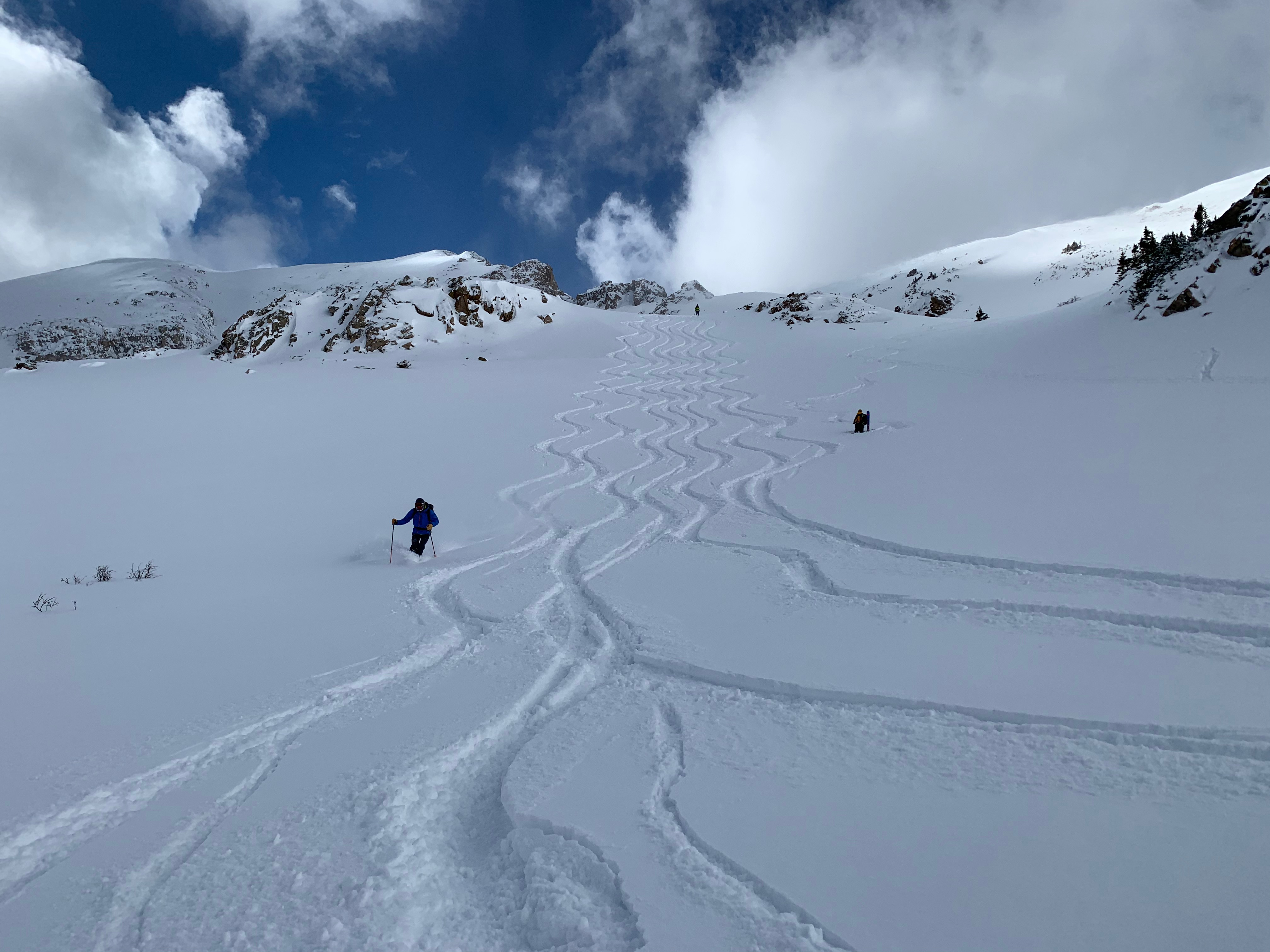 Backcountry skiing tracks in powder snow