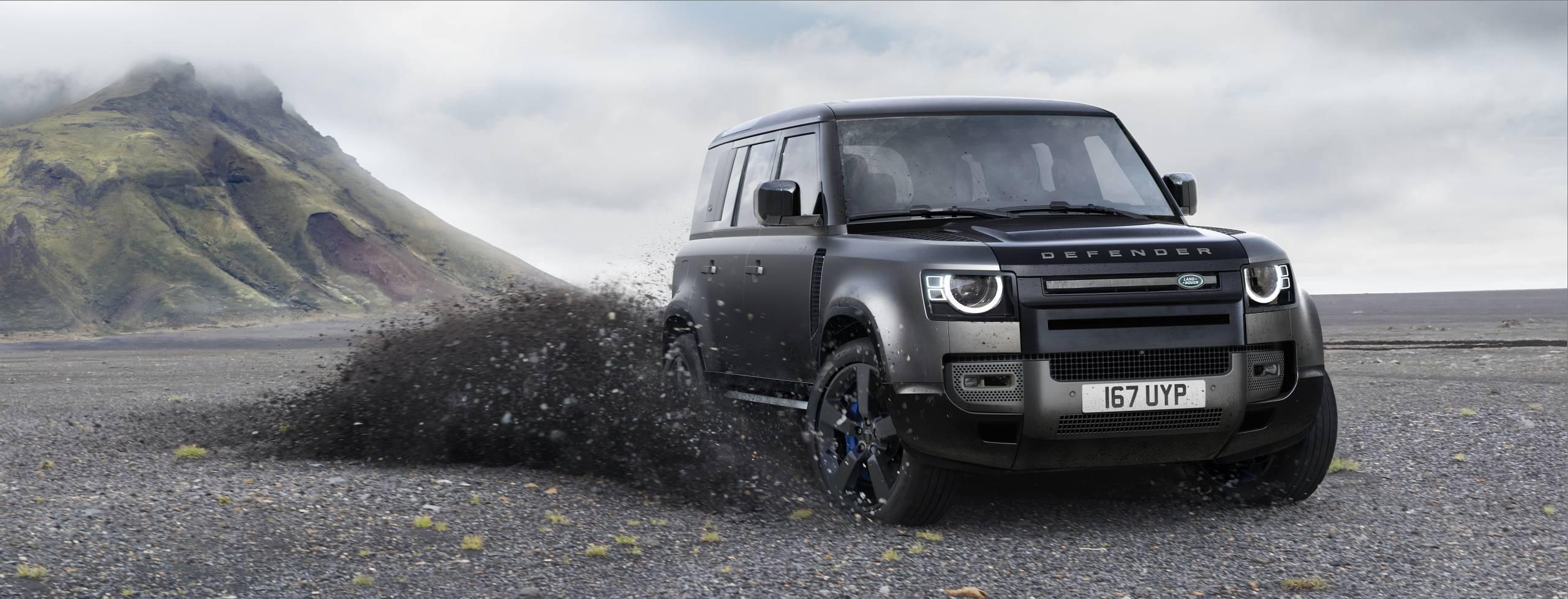 2022 Land Rover Defender 110 V8 Carpathian Edition sliding in gravel