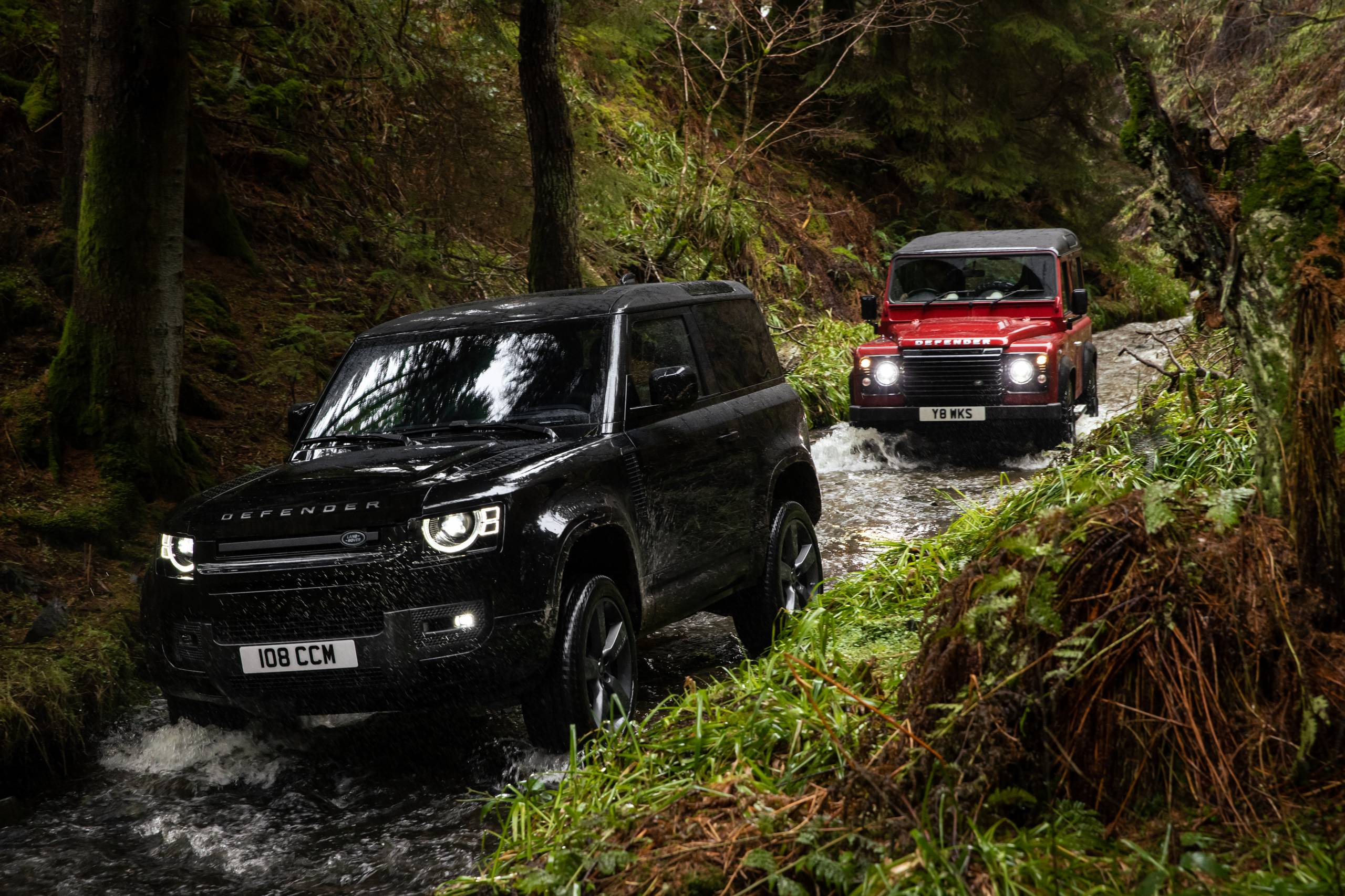 2022 Land Rover Defender 90 and classic Defender in creek bed