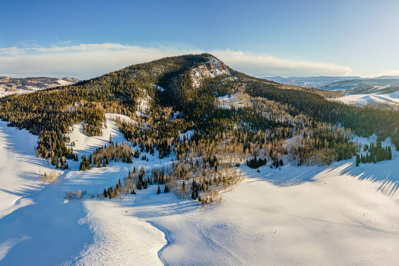A view of pine tree and snow covered Bear mountain looking north