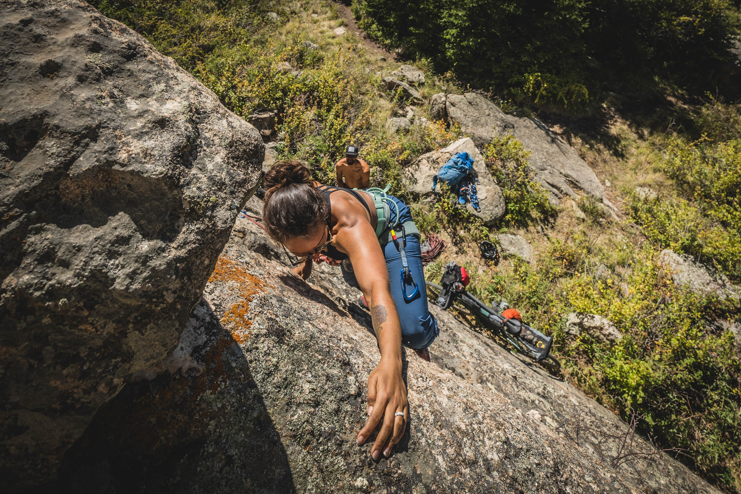 view from above of Rachel Olzer sport climbing on granite