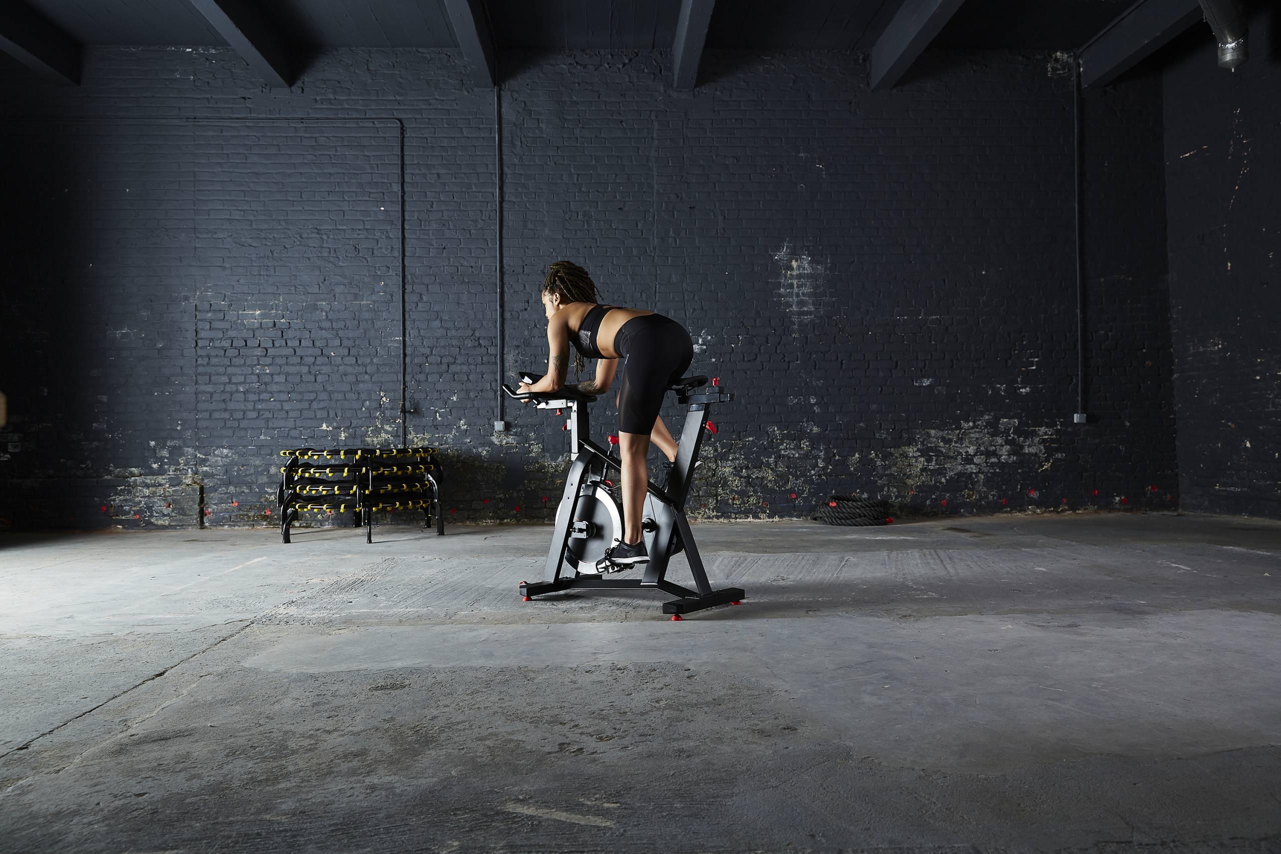 Decathlon Domyos exercise bike woman riding