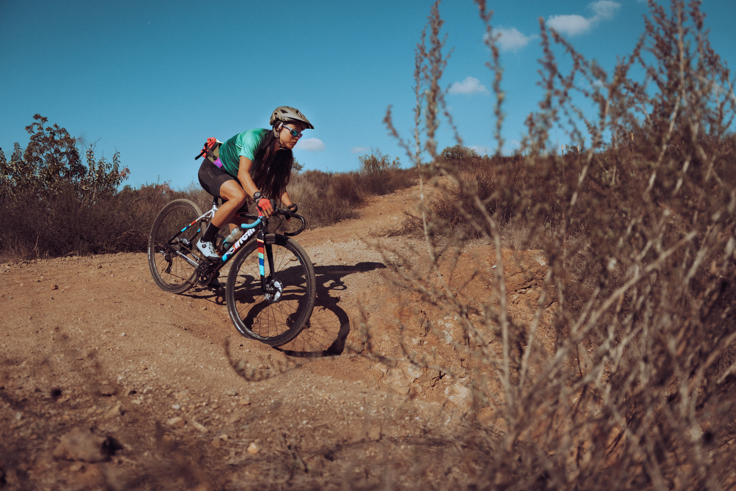 Josie Fouts mountain biking on dirt course