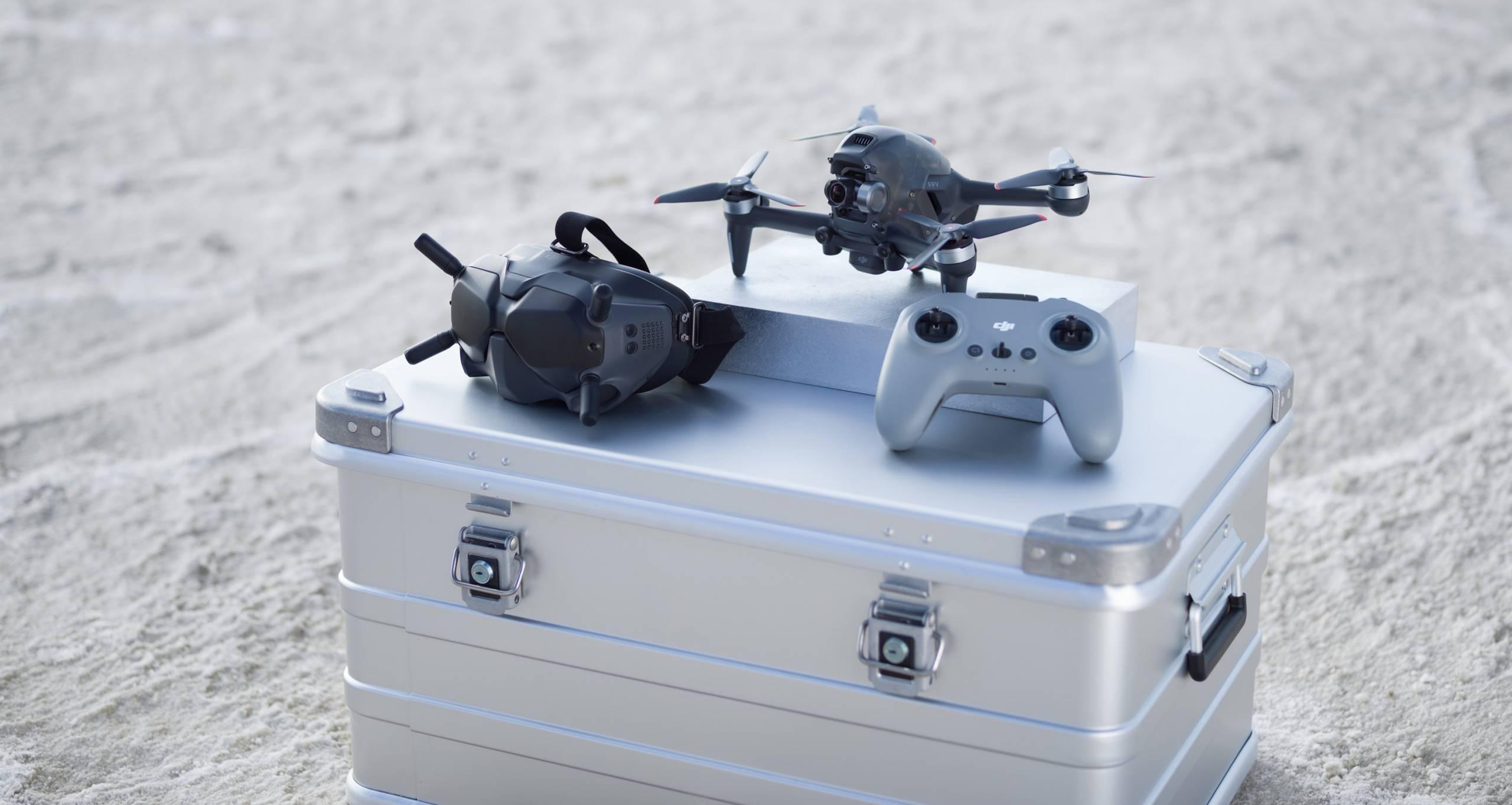 DJI FPV Drone and controller resting on metal gear box